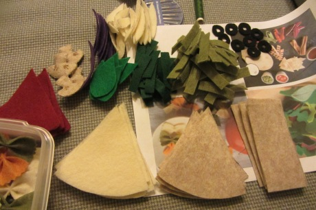 Some of the many, many pieces waiting to be glued and stitched together.